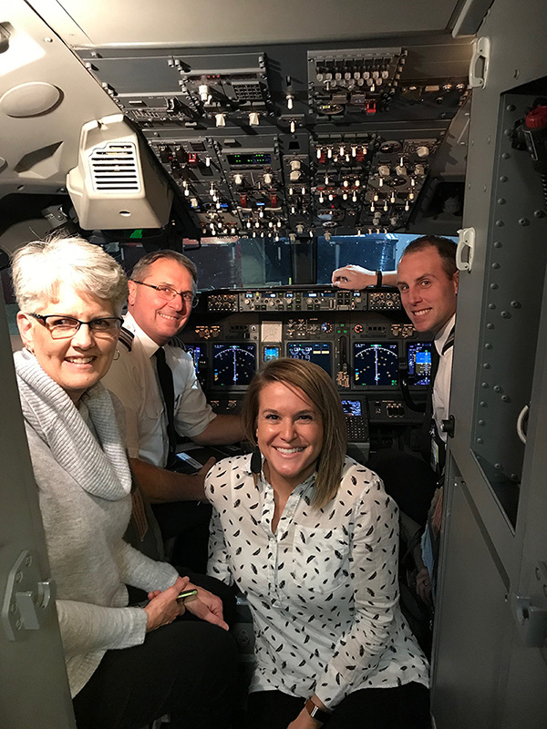 About one year after Matt earned his American Airlines wings, Roger's wife, Rhonda (far left), and Matt's wife, Chelsey (center right), were able to join their pilot husbands on a flight to Miami International Airport (MIA) in 2019.