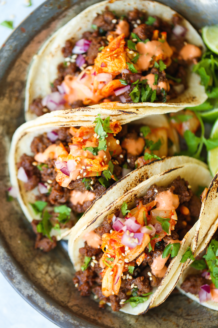 Korean Beef Tacos - Whoa. Guys. These are the most mind-blowing tacos EVER! Filled with everyone's favorite Korean beef, caramelized kimchi + Sriracha mayo!
