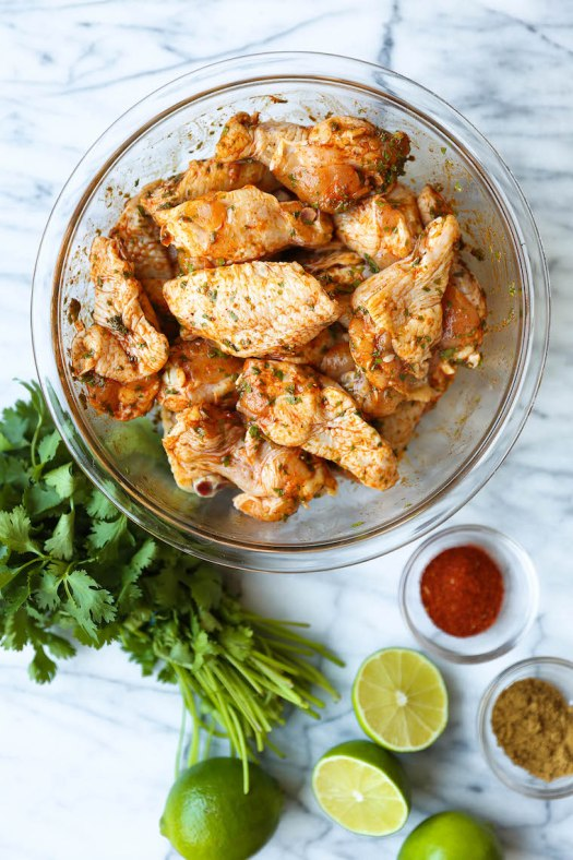 Cilantro Lime Chicken Wings - Oh-so-perfectly crispy, charred + smoky with the easiest marinade. Cilantro, lime, cumin, chili powder. So simple yet so good!