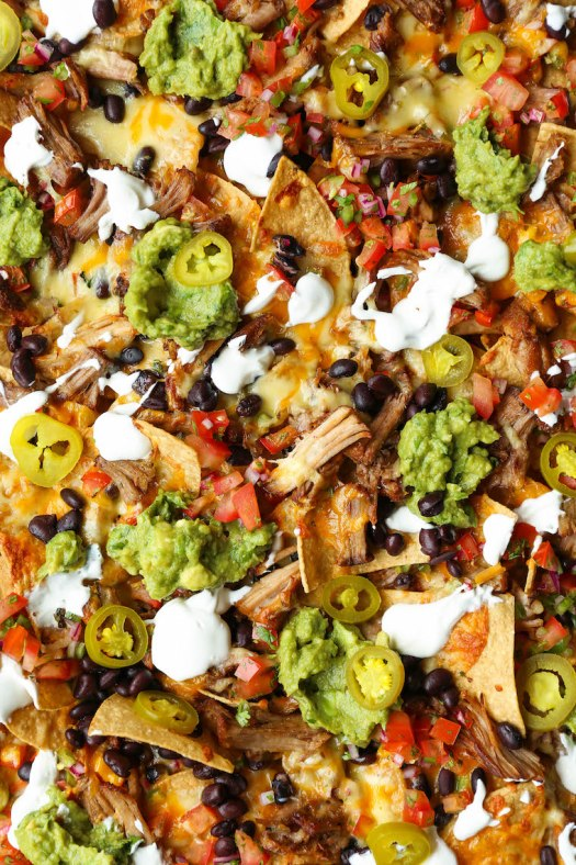 Instant Pot Pulled Pork Nachos - Crowd-pleasing, fully-loaded nachos with the most amazing melt-in-your-mouth, juicy shredded pork. So tender, so good!