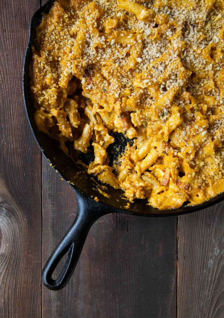 A cast-iron skillet filled with pumpkin macaroni and cheese.