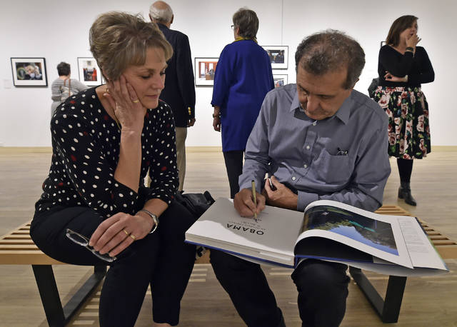 Pete Souza, former White House photographer for Ronald Reagan and Barack Obama, signs a book for Jean Adams at the Sordoni Art Gallery at Wilkes University on Tuesday. Aimee Dilger | Times Leader