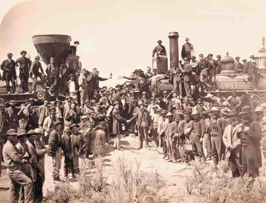 East and West shaking hands at laying of last rail of the Transcontinental Railroad, 1869.  (Photograph: Andrew J Russell/courtesy Union Pacific Railroad Museum)