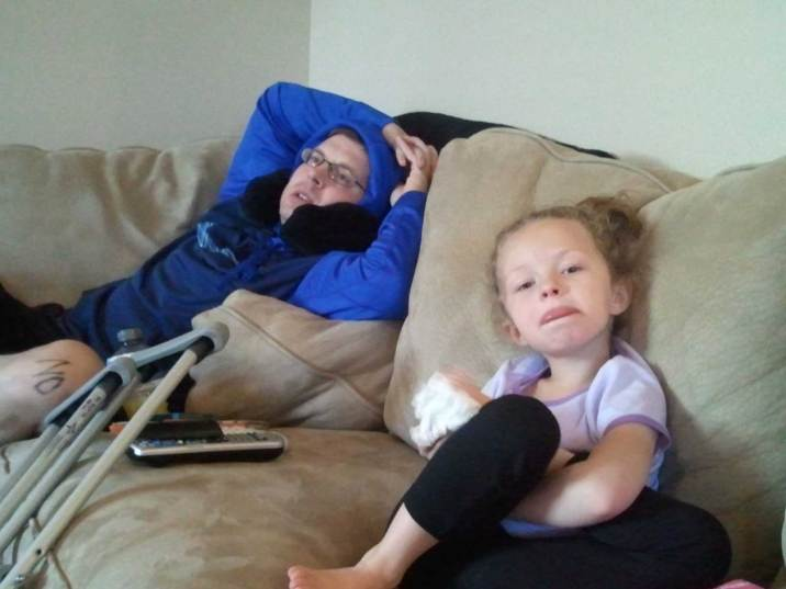 Chris post-surgery with Camryn.
