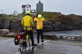 02_Portsmouth_rain gear backs taking lighthouse pic