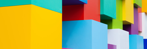 Abstract colorful architectural objects. Yellow, red, green, blue, pink, white colored blocks. Pantone colors concept