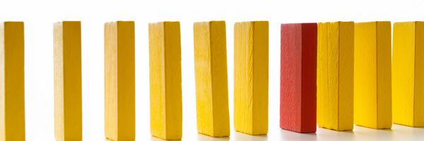 Age discrimination shown with different wooden blocks