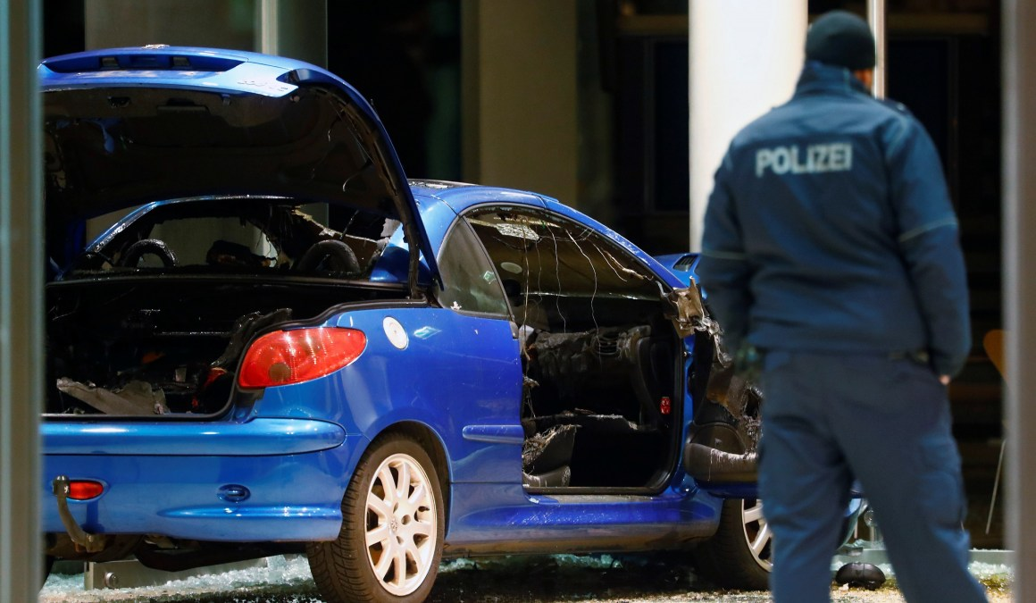 A damaged car is pictured inside the party headquarters of the Social Democratic Party of Germany (SPD) after it crashed into the building in Berlin, Germany, December 25, 2017. Credit: Reuters/Hannibal Hanschke