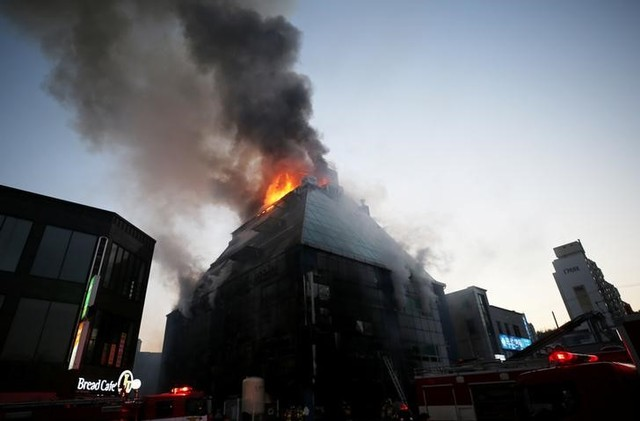 Smoke rises from a burning building in Jecheon, South Korea, December 21, 2017. Yonhap via Reuters