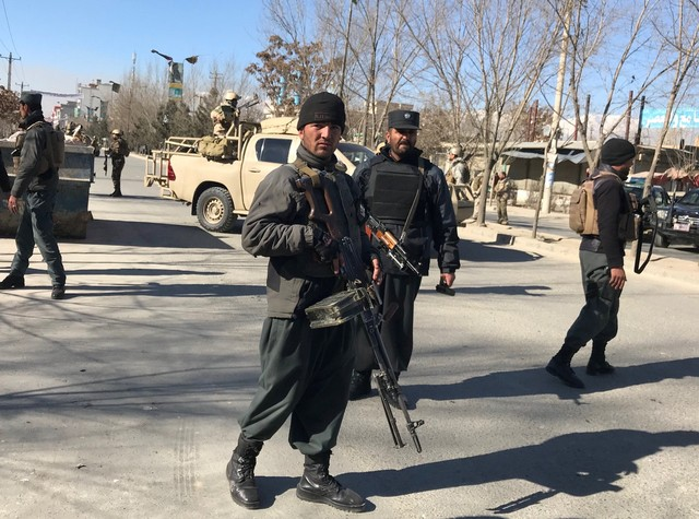 Afghan policemen stand guard at the site of a blast in Kabul, Afghanistan December 28, 2017. Credit: Reuters/Mohammad Ismail
