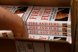 "An employee of Book Culture book store unloads copies of ""Fire and Fury: Inside the Trump White House"" by author Michael Wolff inside the store in New York, US January 5, 2018. Credit:Reuters/Shannon Stapleton"