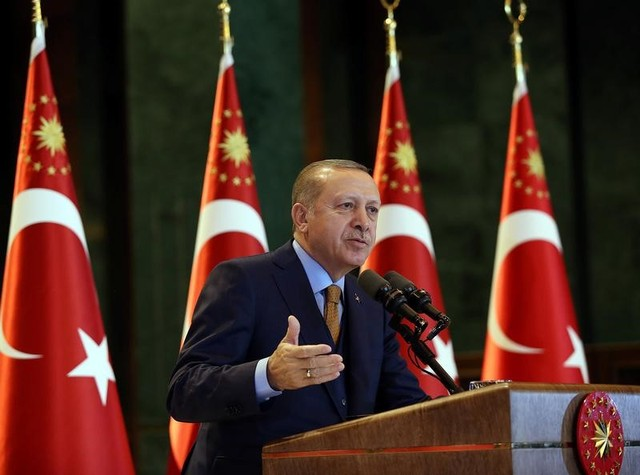 Turkish President Tayyip Erdogan speaks during a meeting at the Presidential Palace in Ankara Turkey