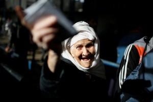 A Palestinian refugee woman gestures as she waits to receive aid at a United Nations food distribution center in Al-Shati refugee camp in Gaza City January 15, 2018. Credit: Reuters/Mohammed Salem