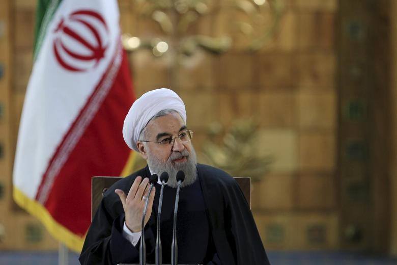 Iranian President Hassan Rouhani gestures as he speaks during a news conference in Tehran