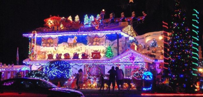 An entire house lit up by Christmas lights.