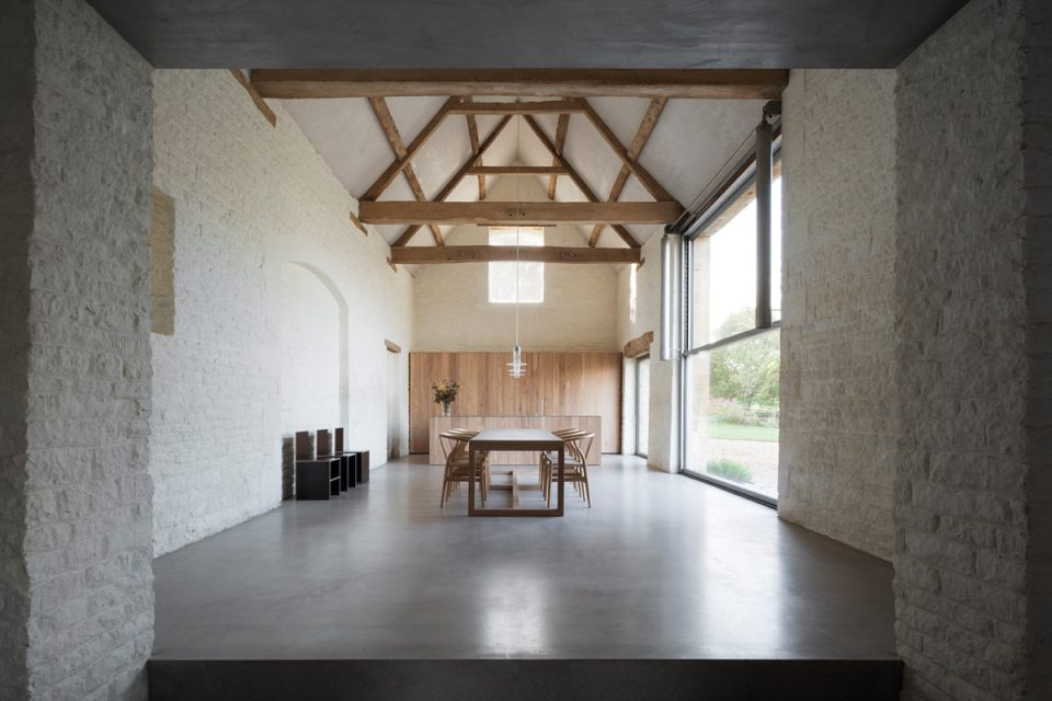 dining room with grey flooring and exposed wood structure