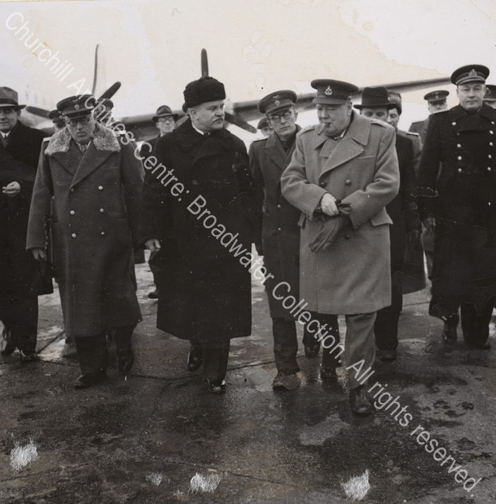 Photo shows WSC wearing an overcoat on arrival in the Soviet Union. He is in conversation with Soviet Foreign Minister Vyacheslav Molotov (wearing a dark greatcoat).
