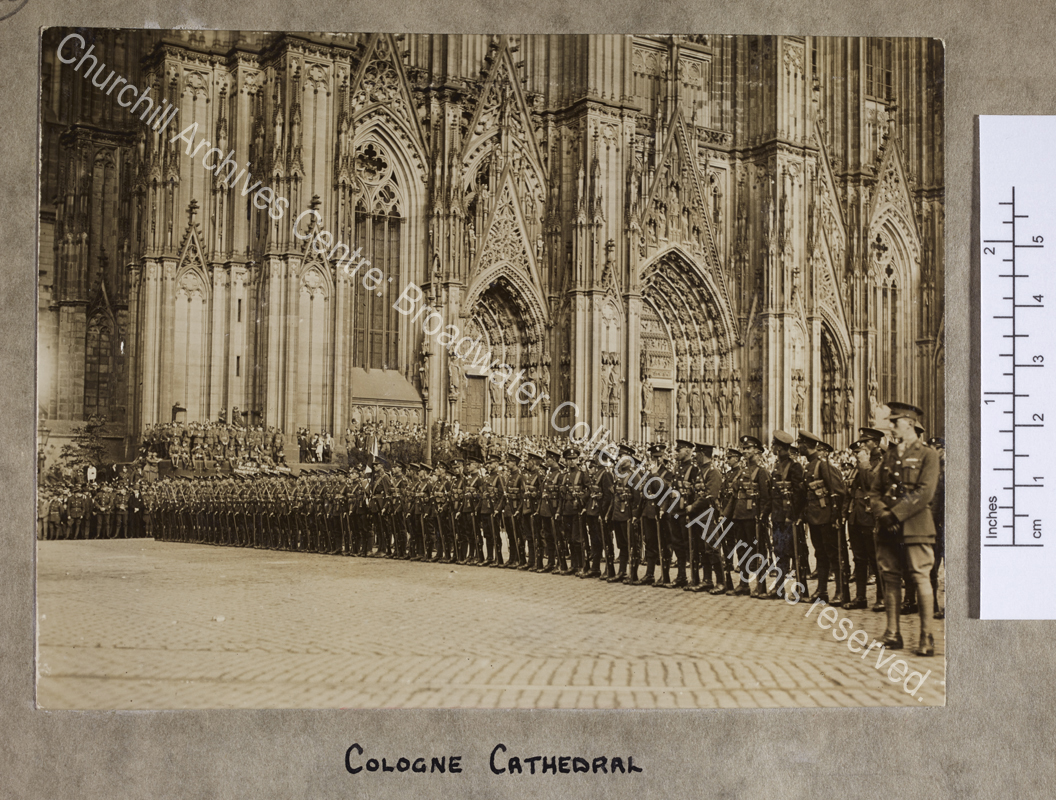 Photograph of troops of the British Army of Occupation [in Germany] drawn up in several lines outside the cathedral