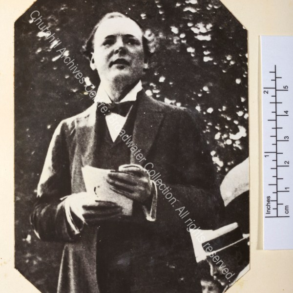 WSC is pictured standing with ?speech notes in his hand.