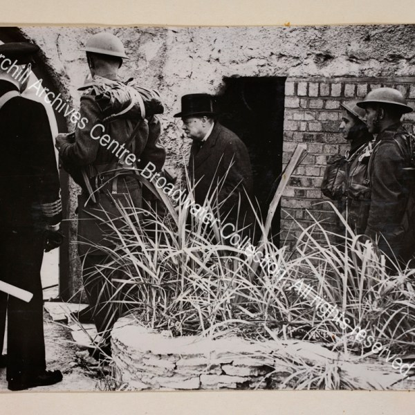Photo showing WSC coming out of the doorway of a shelter