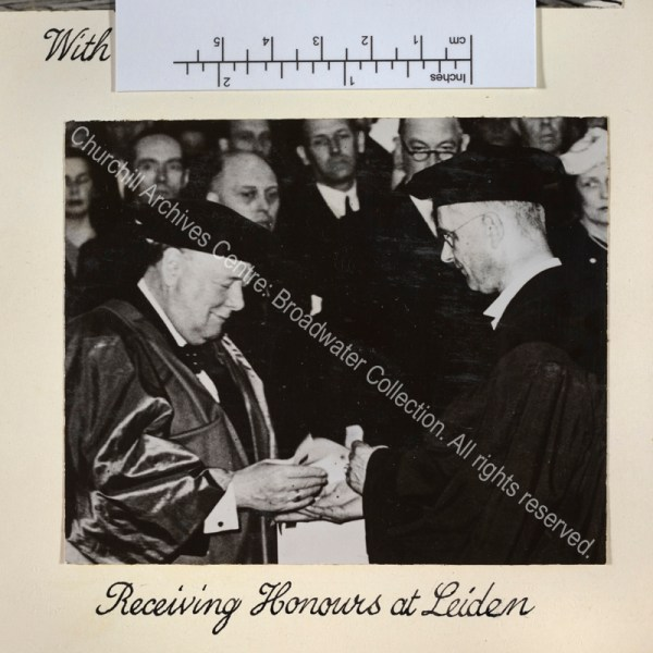 Photo shows WSC being awarded an Honorary Doctorate of Law by Professor Rudolph Cleveringa. WSC is wearing academic dress.