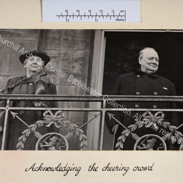 Photo shows WSC and Queen Wilhelmina of the Netherlands standing on a balcony.