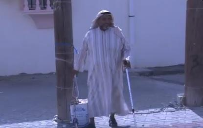 An elderly person puts a rope from his home to the mosque to ensure prayer with the congregation in Jizan