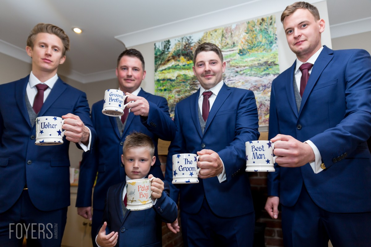 The groom and groomsmen with there Emma Bridgewater, mugs