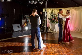 Ally and Alex dancing gracefully to their chosen song, Only Love by Ben Howard with best mad and bridesmaid