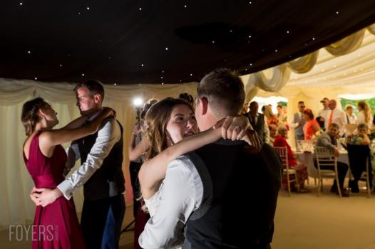 Ally and Alex dancing gracefully to their chosen song, Only Love by Ben Howard with guest