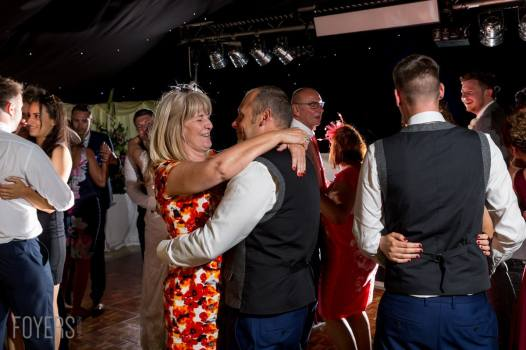 family dancing with Ally and Alex dancing gracefully to their chosen song, Only Love by Ben Howard