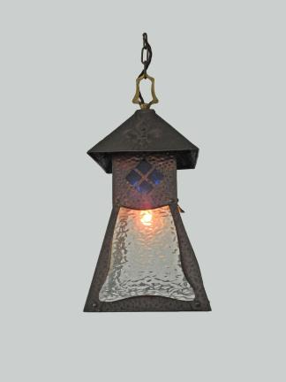 An unusual arts crafts porch lantern