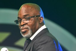 Image result for Buhari bails out cash trapped NFF