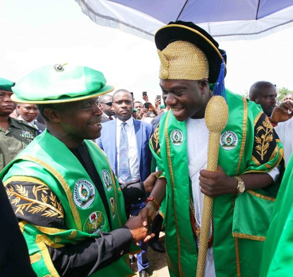 0394 Vice President Prof. Yemi Osinbajo SAN in a handshake with the Royal Father of the Day Ooni of Ife, Oba Adeyeye Enitan Ogunnubi, Ojaja II at the Second Foundation Day Lecture Elizabe University Ilara-Mokin, Ondo State Friday July 8, 2016