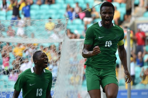 John Obi Mikel (R) of Nigeria celebrates his goal scored against Denmark during the Rio 2016 Olympic Games men's quarter-final football match Nigeria vs Denmark, at the Arena Fonte Nova Stadium in Salvador, Brazil on August 13, 2016 / AFP PHOTO / NELSON ALMEIDA
