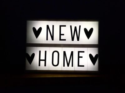 A light box ornament with the words 'New Home'