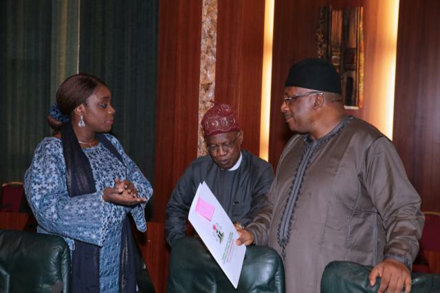 Kemi Adeosun and Lai Mohammed in a dramatic display while Dambazau looks on.