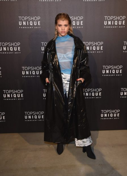 Sophia Ritchie wears, Topshop Boutique Coat, £195, Top, £32 and Topshop SNO Trousers, £70