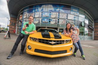Cineworld 3 - Cineworld Unlimited card members, from Birmingham, pose with the Bumblebee outside Cineworld Birmingham-1