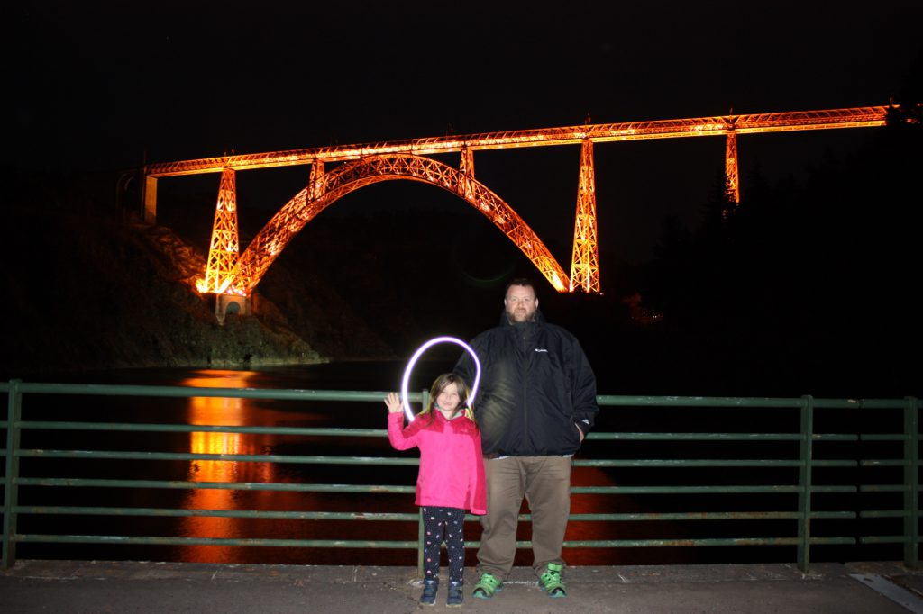 George and Olivia in front of the Garabit viaduct, George has light painted a ring around Olivias head