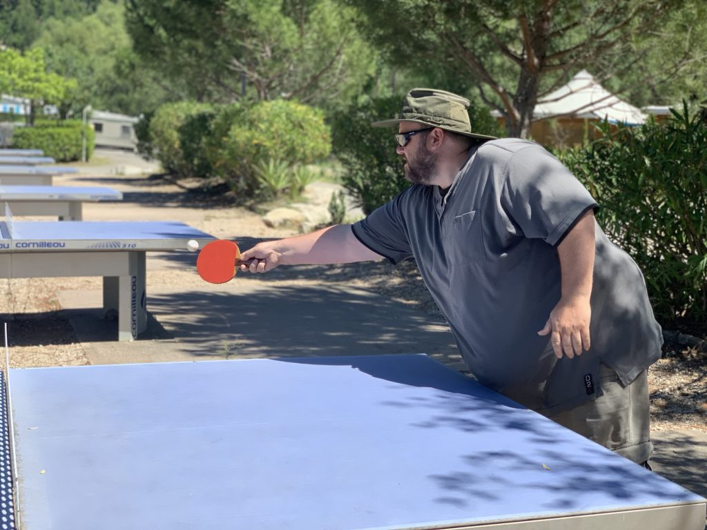 George playing ping pong