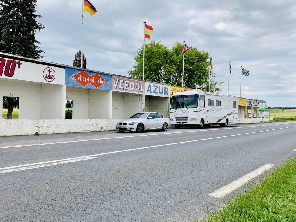 Car and RV at Reims Grand Prix track