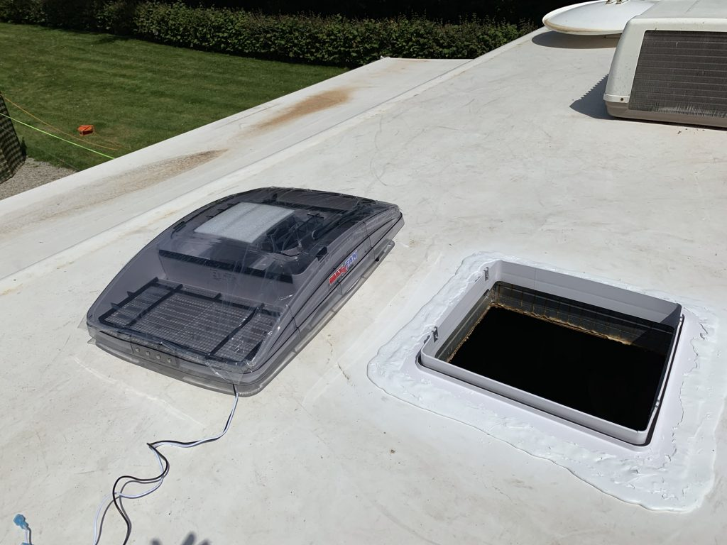 The MaxxFan is sat on the roof next to the vent mount