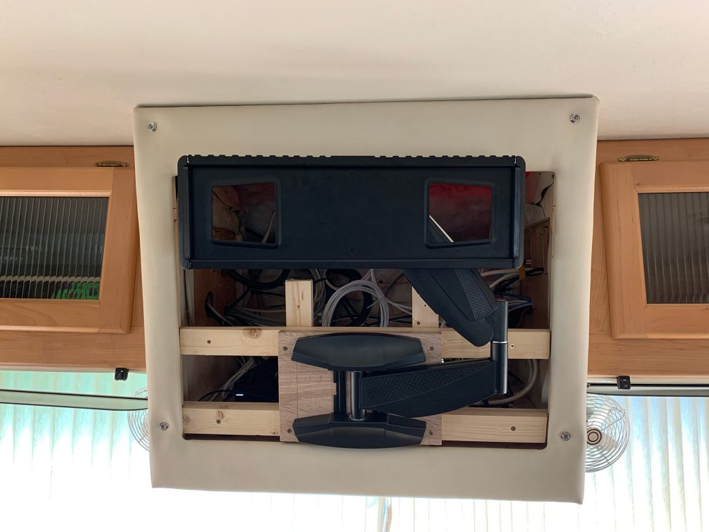The TV cabinet now has the TV mount in place