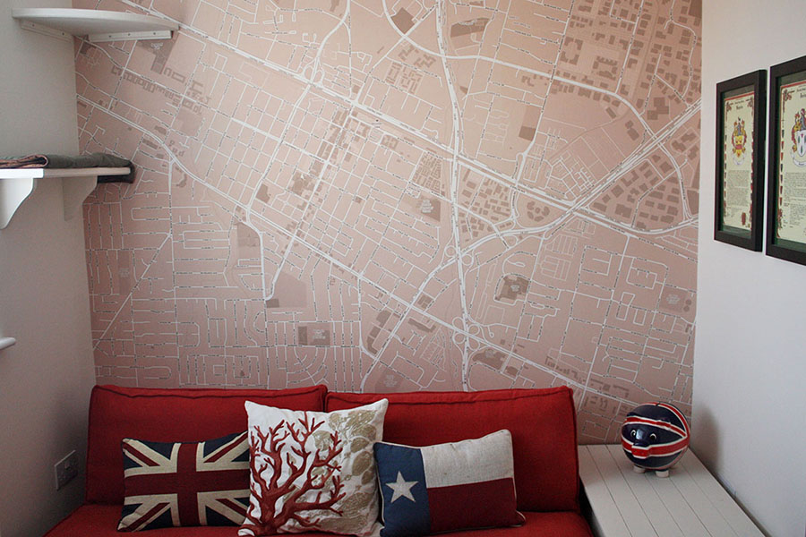 Custom Area map wallpaper in the home with red sofa and cusions