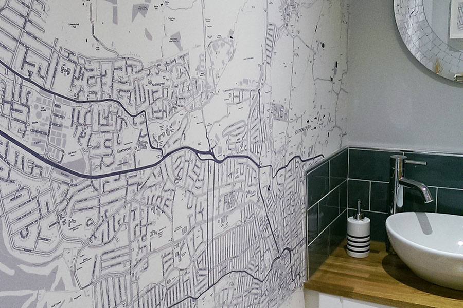Custom Made Map Wallpaper in the bathroom with sink and mirror