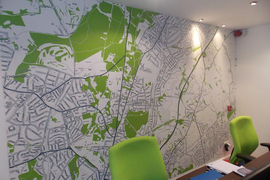Bespoke postcode map wallpaper mural in an office with green chairs