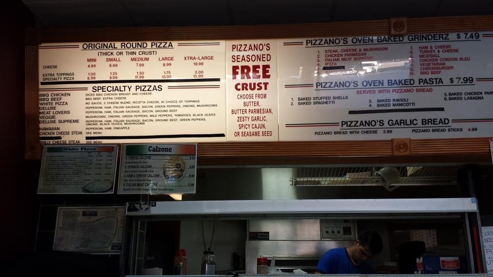 Photo of Pizzano's Pizza & Grinderz - Sebring, FL, United States. Menu board at Pizzano's