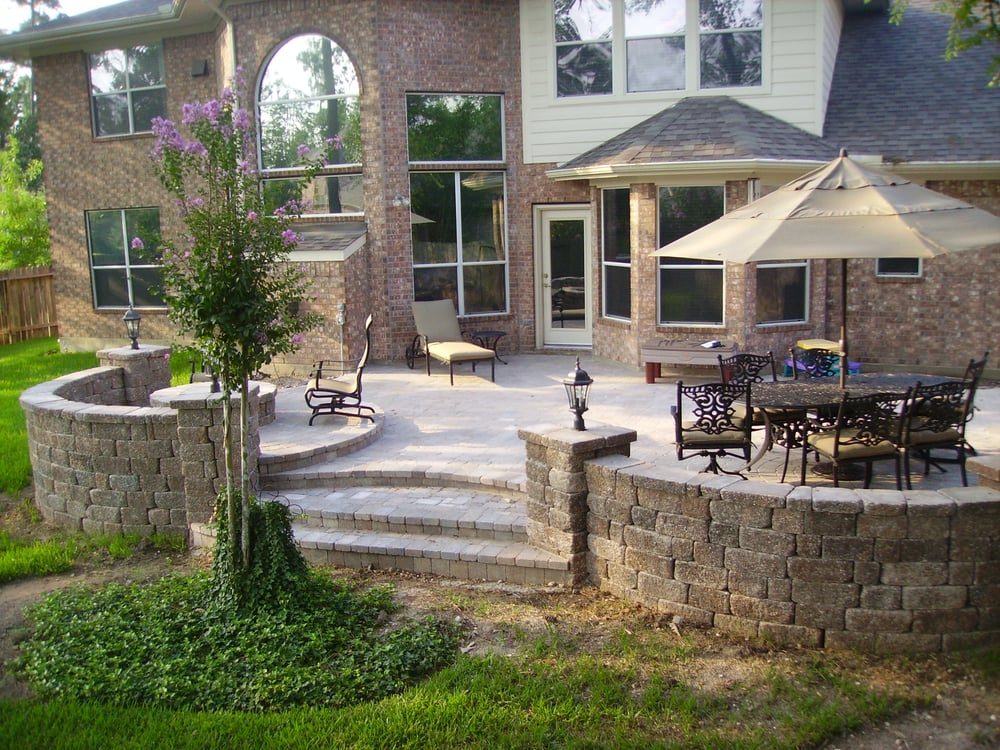 Raised paver patio with bench seating and lighting. - Yelp on Raised Patio Designs  id=39469