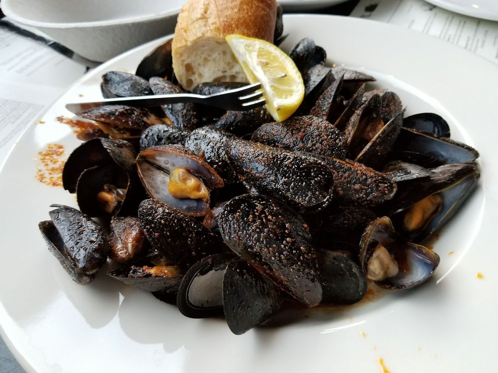 Photo of Mama's On The Half Shell - Baltimore, MD, United States. Cajun butter steamed mussels